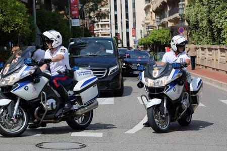 a white police motorcycle: Monte-Carlo, Monaco - May 28, 2016: Police Motorcyclists Escort of the Prince of Monaco during the Monaco Formula 1 Grand Prix 2016
