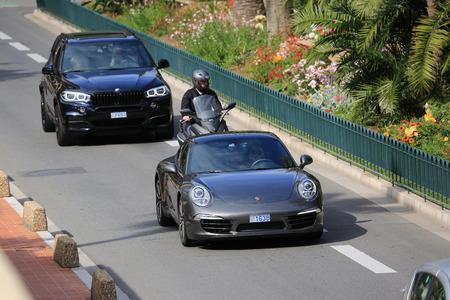 montecarlo: Monte-Carlo, Monaco - May 18, 2016: Beautiful Woman Driving an Expensive Porsche 911 Carrera S on Avenue Princesse Grace in Monte-Carlo, Monaco in the south of France Editorial