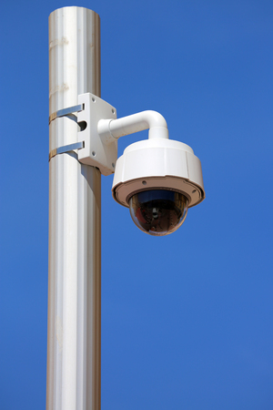 watch city: Outdoor Dome Type CCTV Camera on Street Lamp in Nice, France Stock Photo
