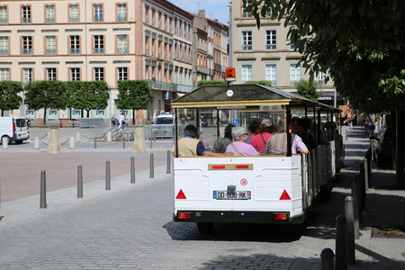 trackless: Albi, France - June 9, 2016:  White Trackless Train for Sightseeing in the Streets of Albi, Commune in Southern France