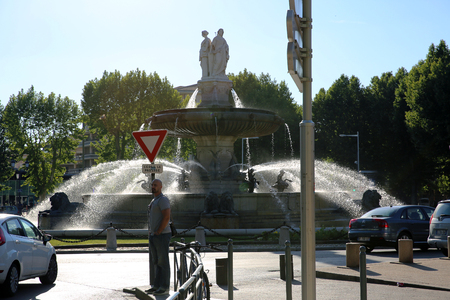 municipal editorial: Aix-En-Provence, France - June 21, 2016: La Rotonde Fountain in Aix-En-Provence in the South of France