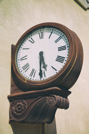 tardiness: Antique External Clock On Railway Station Stock Photo
