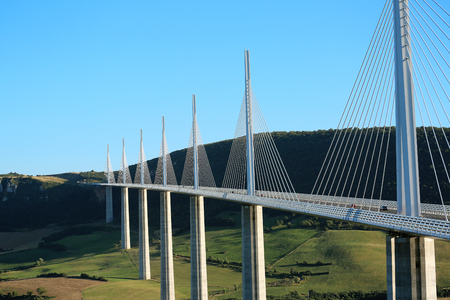 above 21: Millau, France - August 21, 2016: The Millau Viaduct Is The Tallest Bridge In The World with One Masts Summit At 343 Metres Above The Base Of The Structure. Aveyron, Midi Pyrenees, France