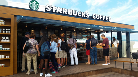 Monte-Carlo, Monaco - September 26, 2016: Customer Line Up For Buying Coffee, Cakes Or Frappuccino At Starbucks In Monaco, French Riviera
