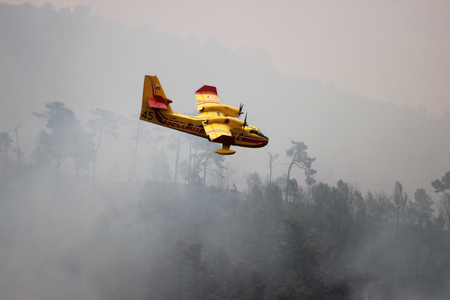 Menton, France - September 9, 2015: Canadair CL-415 (Bombardier 415 Superscooper) Airplane Extinguish Forest in Flame in Menton, French Riviera