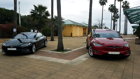 Menton, France - March 3, 2018: Luxury Black Tesla Model S And Red Tesla X Model Electric Cars Parked on a Square in Menton on The French Riviera Editorial