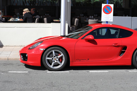 Menton, France - March 19, 2018: Luxury Red Porsche 718 Cayman S Badly Parked Car In The Street Of Menton On The French Riviera
