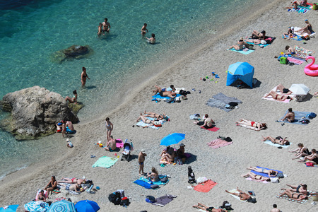 Villefranche-sur-Mer, France - May 20, 2018: Aerial View Of People Relaxing Vacation Sea Beach Destination. Swimming In Clear Sea Water In The French Riviera, France, Europe Banque d'images - 102451368