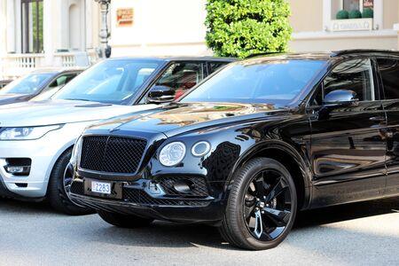 Monte-Carlo, Monaco - September 19 2018 : Two Luxurious SUVs Parked In Front Of Monte Carlo Casino In Monaco : Black Bentley Bentayga And Silver Range Rover