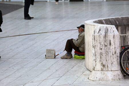 Paris, France - October 16, 2018: Homeless Man Begging In Paris Streets. District Defense, Europe Editorial
