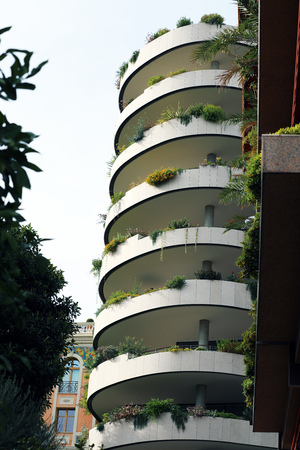 Modern Architecture And Ecologic Skyscrapers With Much Green Plants And Beautiful Trees On Every Balcony 스톡 콘텐츠