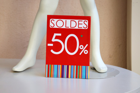 50% Off Sale Red Sign In A Clothes Shop in France, Europe
