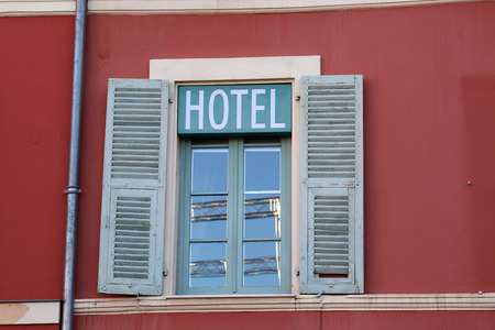 Hotel Sign Over Window In Nice, France, Europe. Close Up View 스톡 콘텐츠