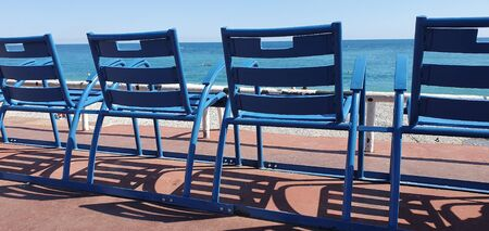 Blue Chairs Along The Promenade Des Anglais In Nice, Symbol Of Nice, Mediterranean Sea, French Riviera, France, Europe 스톡 콘텐츠
