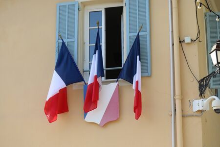 French Tricolor Flags On The Town Hall (La Mairie) Of Castellar In France, French riviera, Europe - Close Up View