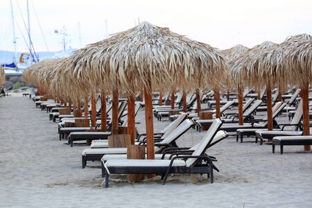 Black Sea Sand Beach With Wooden Sun Loungers And Straw Umbrellas At Sveti Vlas, Bulgaria, Europe