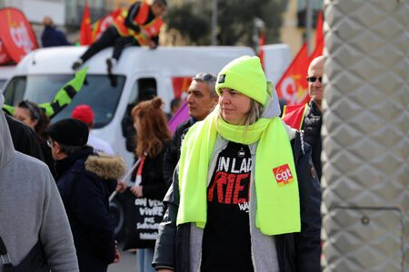 Nice, France - February 6, 2020: French Woman In Yellow Vest (Gilets Jaunes) Protesting Against The Macron Government's Pension Reform Plan In Nice On The French Riviera, France, Europe