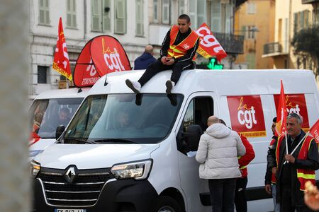 Nice, France - February 6, 2020: CGT Unionists March Protest Against The Macron Government's Pension Reform Plan, Man On The Roof Of A Truck In Nice On The French Riviera, France, Europe - Close Up View Editorial