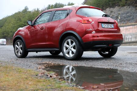 Savines-Le-Lac - January 26, 2020: Red Nissan Juke Crossover SUV Car Parked On The Side Of Road In Crots, Hautes-Alpes, French Alps, France, Europe. Close Up Rear View Editorial