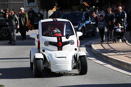 Monte-Carlo, Monaco - March 17, 2019: Young Man Driving A Luxurious White Renault Twizy In Front Of The Monte-Carlo Casino In Monaco On The French Riviera, Europe. Close Up View