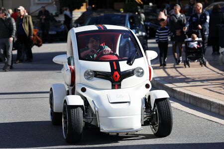 Monte-Carlo, Monaco - March 17, 2019: Young Man Drives A Luxurious White Renault Twizy In Front Of The Monte-Carlo Casino In Monaco On The French Riviera, Europe. Close Up View Editöryel