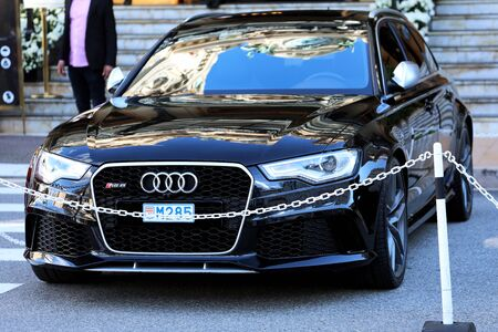 Monte-Carlo, Monaco - March 17, 2019:  Luxury Black Audi RS6 Parked In Front Of The Monte-Carlo Casino In Monaco On The French Riviera, Europe. Close Up Front View