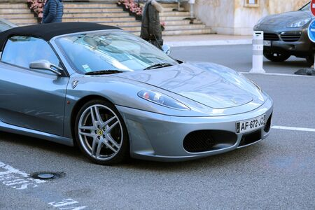 Monte-Carlo, Monaco - March 17, 2019: Man Drives A Luxurious Ferrari F430 Spider In Front Of The Monte-Carlo Casino In Monaco On The French Riviera, Europe. Close Up View Editorial