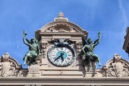 Clock With Bronze Sculptures Of Angels Above The Main Entrance Of Monte-Carlo Casino In Monaco
