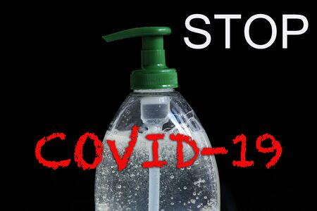 STOP COVID-19 Text, Clean Your Hands Often, Infection Prevention Coronavirus Concept, Rising Soap Bubbles In Pump Bottle On The Black Background. Close Up / Macro Shot Foto de archivo