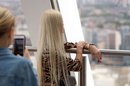London, UK, May 29, 2019: Woman Photographing A Blonde Woman With Her Smartphone, Aerial view From Skyscraper In London, United Kingdom, Europe Editorial