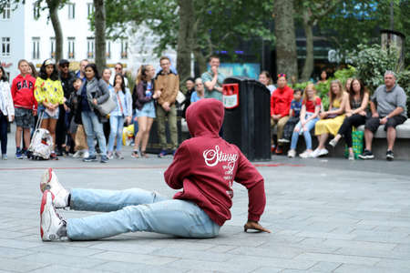 London, UK, May 31, 2019: Hip Hop Street Dance Moves In Leicester Square In London With Audience Watching Break Dancer Street Performers. Close Up View