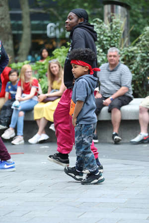 London, UK, May 31, 2019: Little Boy Breakdancing On The Street, Hip Hop Street Dance Moves In Leicester Square In London With Audience Watching Break Dancer Street Performers Editorial