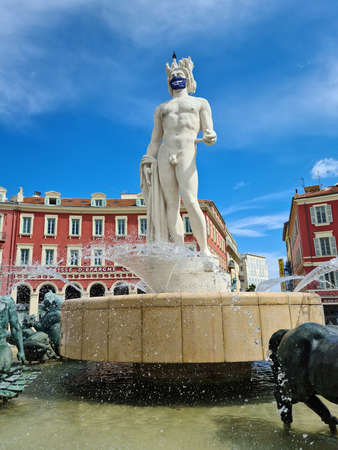 Nice, France - June 9, 2020: Fountain Of The Sun (Fontaine Du Soleil), Statue Of Apollo With Surgical Mask During Covid-19 Time On Place Massena In Nice, French Riviera, France, Europe