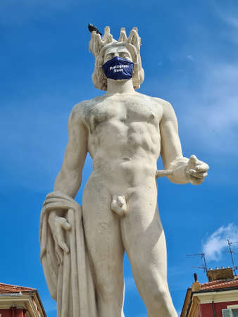 Nice, France - June 9, 2020: Apollo With Surgical Mask During Covid-19 Time, Fountain Of The Sun With A Marble Statue Of On Place Massena In Nice, French Riviera, France, Europe Editorial
