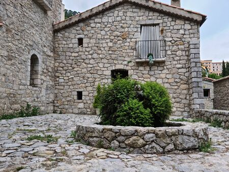 Old stone Fountain In The French Medieval Village Of Peille, South Of France, Europe Foto de archivo