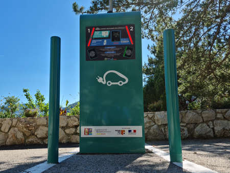 Roquebrune-Cap-Martin, France - June 5, 2020: Electric Vehicle Charging Station With Payment Badge In Roquebrune-Cap-Martin On The French Riviera, France, Europe