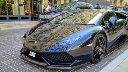 Monte-Carlo, Monaco - August 8, 2020: Black lamborghini Huracan Supercar Parked in Front Of The Hotel Hermitage In Monte-Carlo, Monaco, Europe. Close Up View Editorial