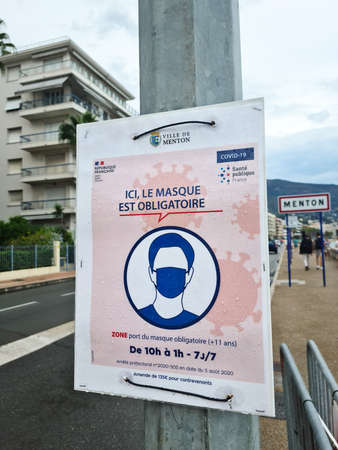 Menton, France - August 29, 2020: Coronavirus COVID-19 Face Mask Is Mandatory In The City Center Of Menton Says This Street Sign, France, Europe