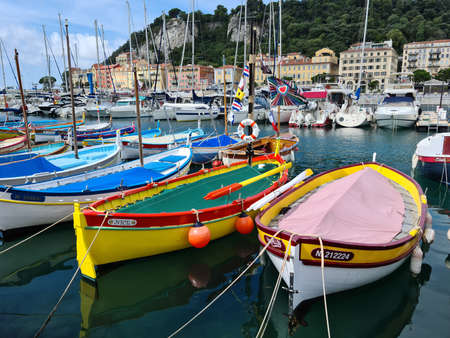 Nice, France - August 18, 2020: Small Colorful Wooden Fishing Boats Moored In The Old Port Of Nice, French Riviera, France, Europe Editorial