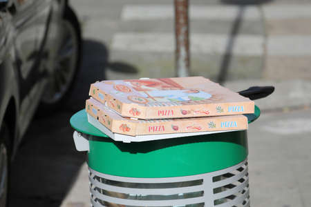 Nice, France - January 29, 2019: Empty Pizza Boxes On A Trash Can In The Street In Nice On The French Riviera, France, Europe Editorial