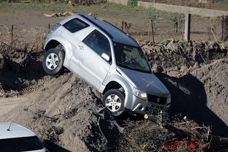 Breil-Sur-Roya, France - October 8, 2020: Town Of Breil-Sur-Roya Was Submerged By The Flooding Of The Roya River, Suzuki Grand Vitara SUV Car Completely Destroyed During Storm Alex, Europe