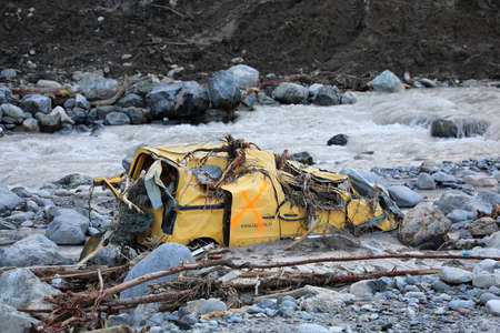 Breil-Sur-Roya, France - October 8, 2020: Breil-Sur-Roya French Village Was Submerged By The Flooding Of The Roya River, La Poste Yellow Van Completely Destroyed During Storm Alex, Europe Editorial