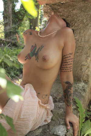 hot sexy girls: Wild Tattoo Attractive Nude girl Stock Photo