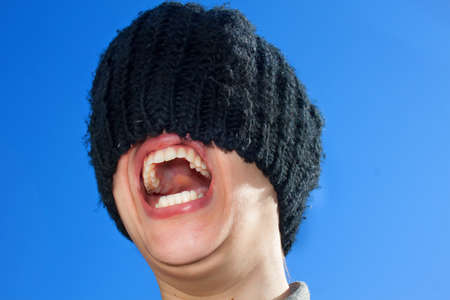 Girl with Hat on Face Screaming photo