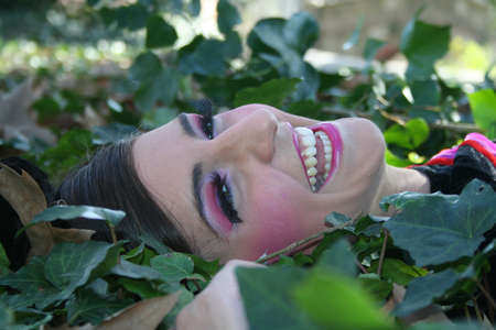 Smiling Model in Nature Park Close up photo