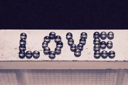b w: Love sign from marbles. Stock Photo