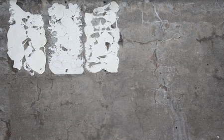 Distressed concrete wall with sign adhesive residue Reklamní fotografie
