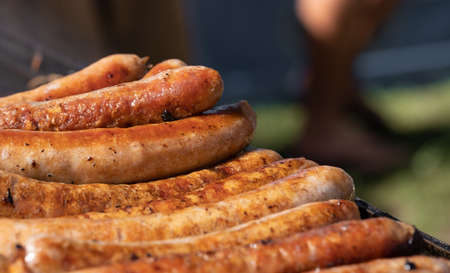 Closeup image of cooked sausages at an Australian election barbecue fund raiser Stock Photo - 119953414