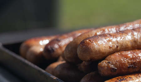 Closeup image of cooked sausages at an Australian election barbecue fund raiser Stock Photo - 119953421