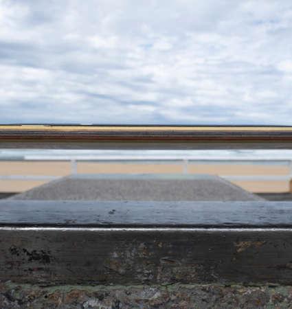 Close up of skateboard edge at a beachside skate park.